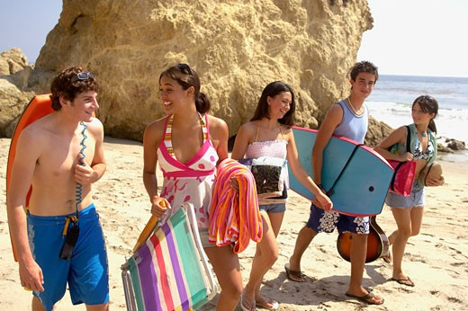 Stock Photo: 1779R-21647 Teenagers walking on beach