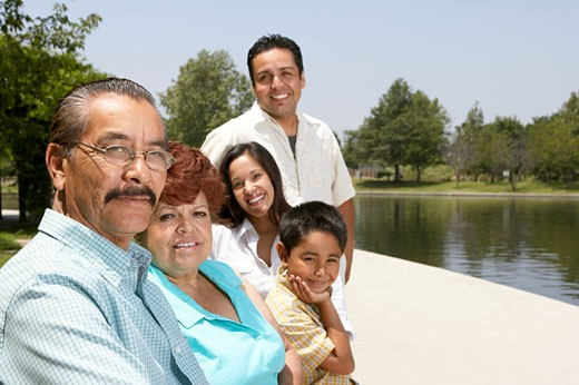 Stock Photo: 1779R-21779 Hispanic family sitting by lake