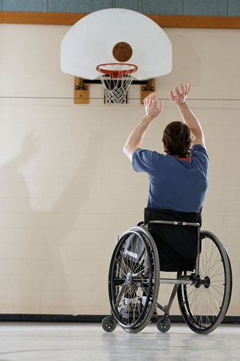 Stock Photo: 1779R-22017 Wheelchair-bound man shooting basket
