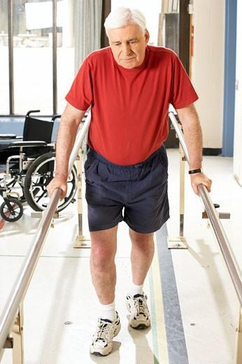 Man using bars to walk : Stock Photo