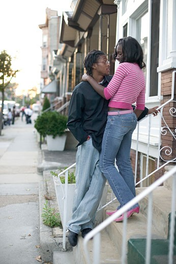 Stock Photo: 1779R-22399 African couple hugging on doorstep