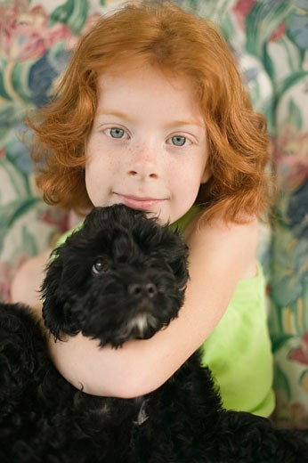 Young girl hugging her dog : Stock Photo