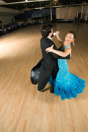 Professional dancers practicing in ballroom : Stock Photo