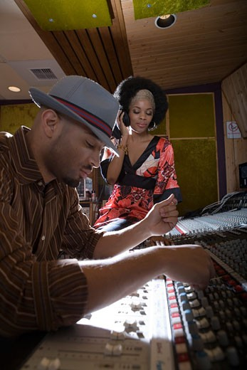 Producer and musician in recording studio : Stock Photo