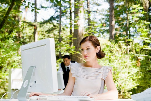 Stock Photo: 1779R-23213 Businesswoman at desk in woods