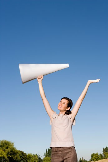 Woman holding megaphone over head : Stock Photo