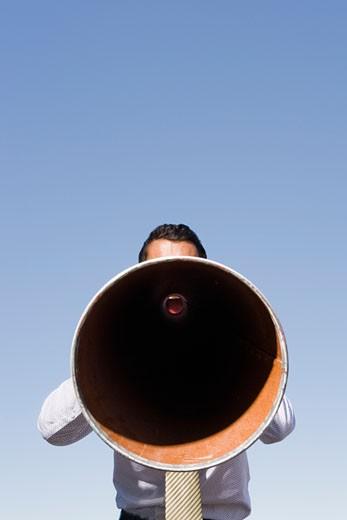 Stock Photo: 1779R-23227 Businessman yelling through megaphone