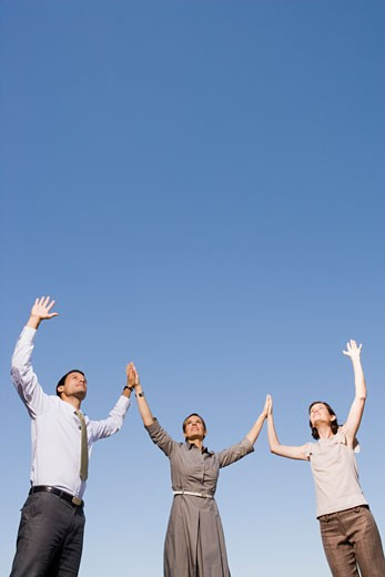 Stock Photo: 1779R-23228 Businesspeople with arms raised