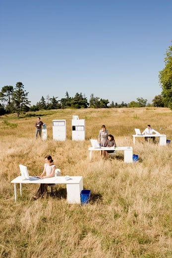 Stock Photo: 1779R-23233 Businesspeople working in field