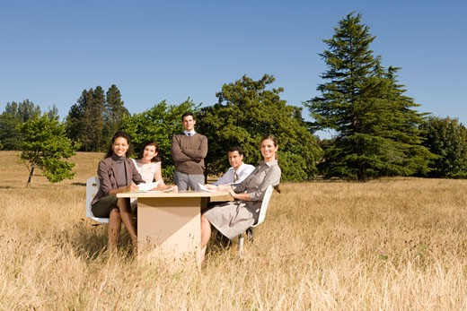 Stock Photo: 1779R-23248 Businesspeople at conference table in field
