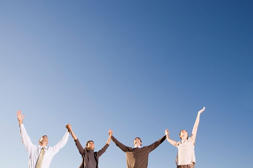 Stock Photo: 1779R-23278 Businesspeople with arms raised