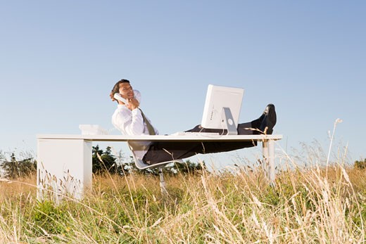 Stock Photo: 1779R-23283 Businessman at desk in field