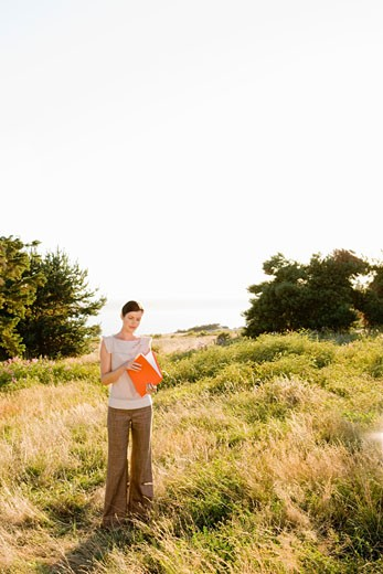 Businesswoman standing in field : Stock Photo