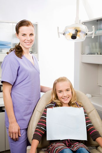 Stock Photo: 1779R-23438 Female dentist and girl in dental office