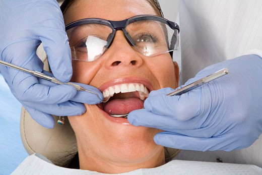 Stock Photo: 1779R-23464 Woman being examined by dentist