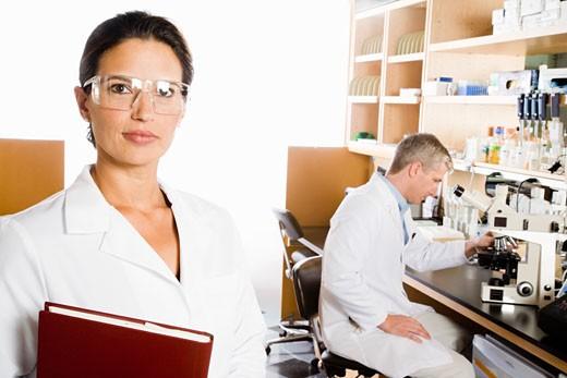 Female scientist wearing protective eyewear : Stock Photo