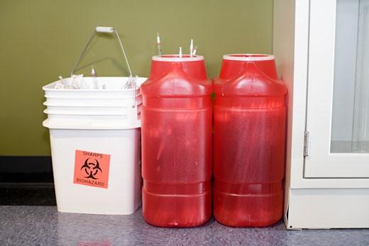 Stock Photo: 1779R-23727 Biohazard bins along wall