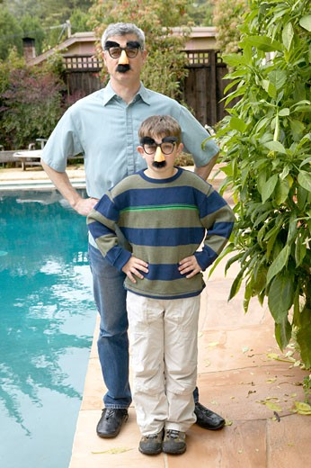 Father and son in disguises  : Stock Photo