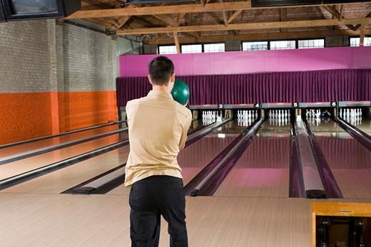 Man preparing to throw bowling ball : Stock Photo