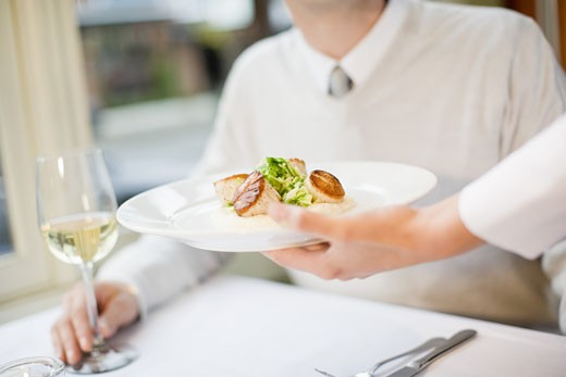 Stock Photo: 1779R-24239 Man being served at restaurant