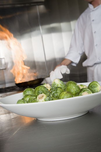 Plate of brussels sprouts in kitchen : Stock Photo