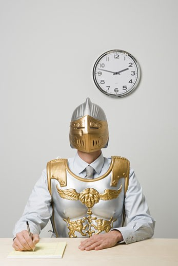 Stock Photo: 1779R-24487 Businessman wearing gladiator armor