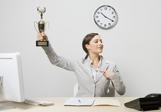 Businesswoman holding trophy : Stock Photo