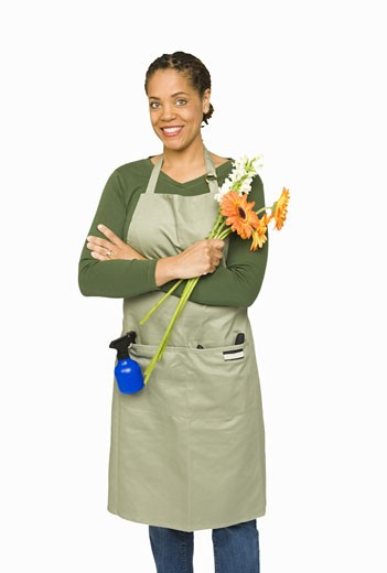 African woman holding cut flowers : Stock Photo