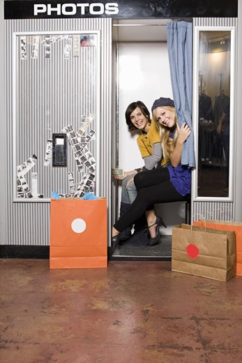 Women sitting in photo booth : Stock Photo