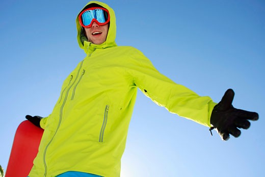 Stock Photo: 1779R-25236 Snowboarder with arm outstretched