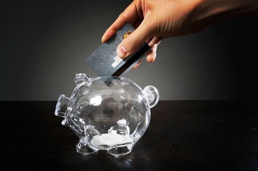 Credit card in piggy bank : Stock Photo