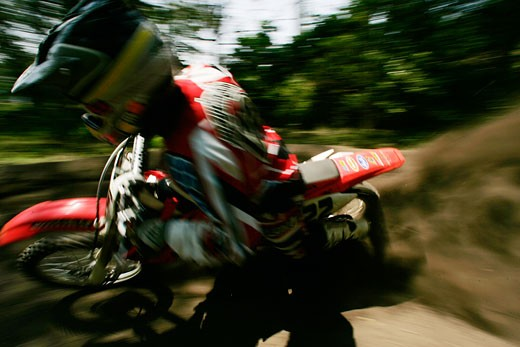 Blurred motorcyclist turning : Stock Photo