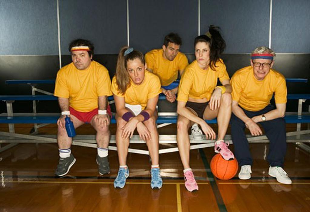 Basketball team sitting on bleachers : Stock Photo