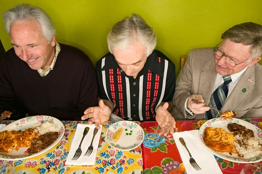 Stock Photo: 1779R-3375 Senior man with tiny plate of food