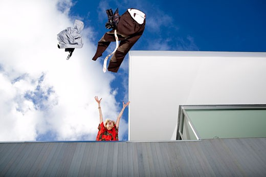 Stock Photo: 1779R-3535 Woman throwing her husband's clothes over a balcony