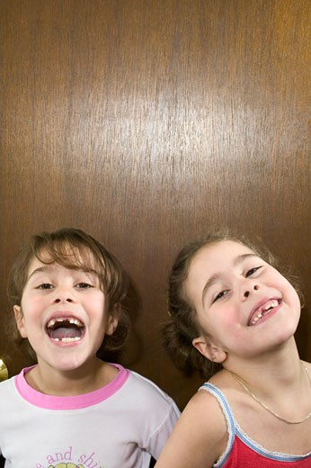 Stock Photo: 1779R-3600 Young girls displaying their missing teeth