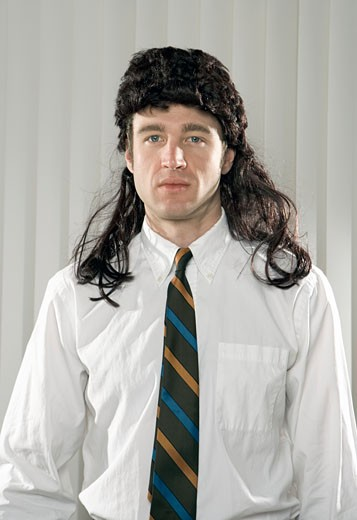 Businessman wearing mullet wig : Stock Photo