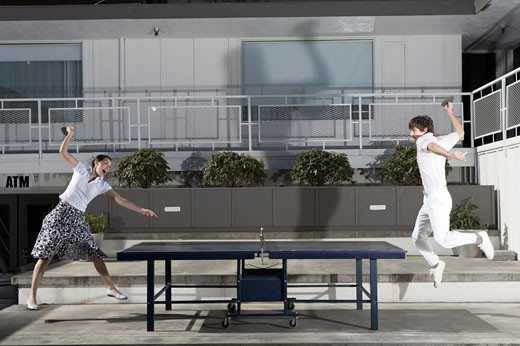 Stock Photo: 1779R-3723 Couple playing ping-pong