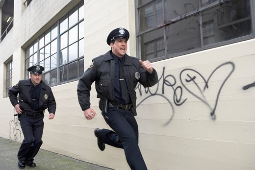 Male police officers running : Stock Photo