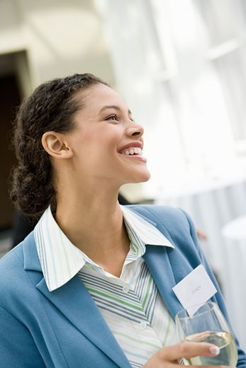 African businesswoman wearing name tag : Stock Photo