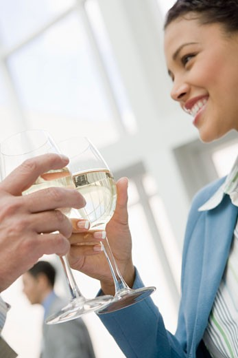 African businesswoman toasting with wine : Stock Photo