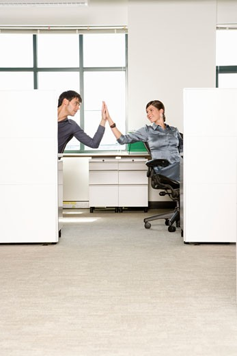 Stock Photo: 1779R-4960 Businesspeople high-fiving