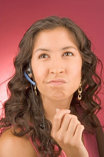 Portrait of young woman with headset : Stock Photo