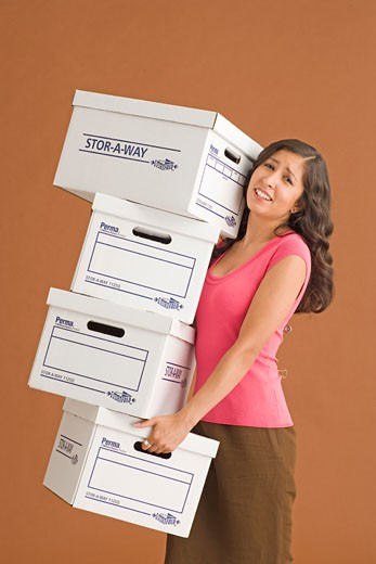 Stock Photo: 1779R-5664 Young woman holding boxes
