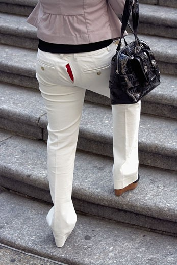 Stock Photo: 1779R-6079 Split in the seat of woman's pants