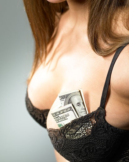 Woman with money in her bra : Stock Photo