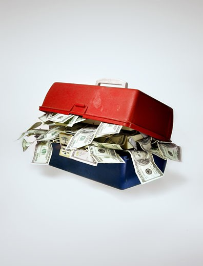 Tackle box stuffed with currency : Stock Photo