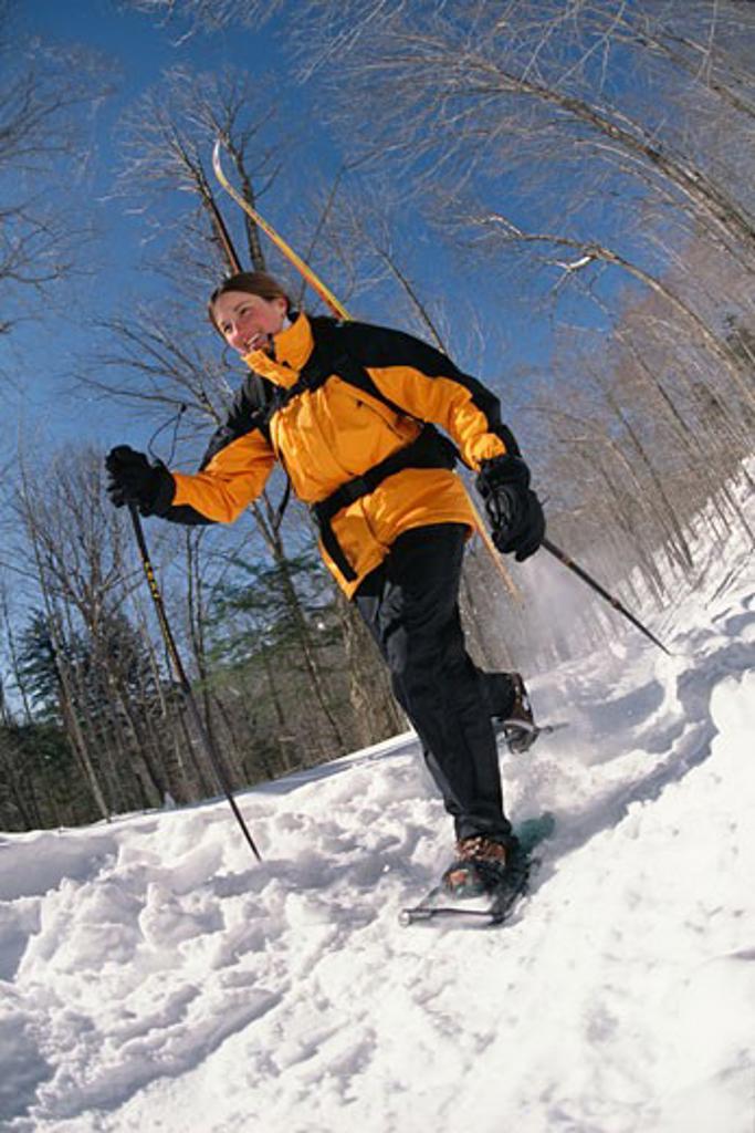 Woman snowshoeing : Stock Photo