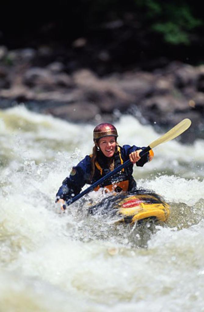 Stock Photo: 1779R-6788 Woman whitewater kayaking
