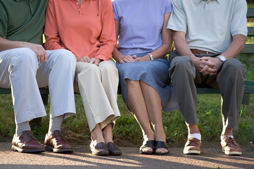 Stock Photo: 1779R-6922 Low section view of people sitting on park bench